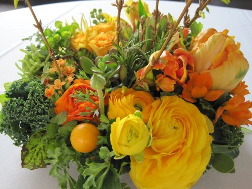 spring arrangement with ranunculus, tulips, roses and citrus, Françoise Weeks
