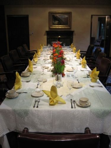 flower garland for head table; bright flowers in wheatgrass, Lewis&Clark College, Françoise Weeks