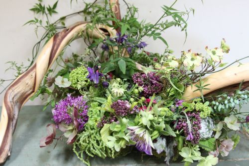 woodland arrangement  with paretially sanded juniper branch and spring flowers, FranJoise Weeks