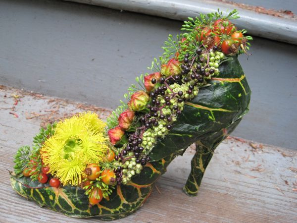 botanical shoe  with croton leaves, rosehips, eucalyptus pods, Françoise Weeks