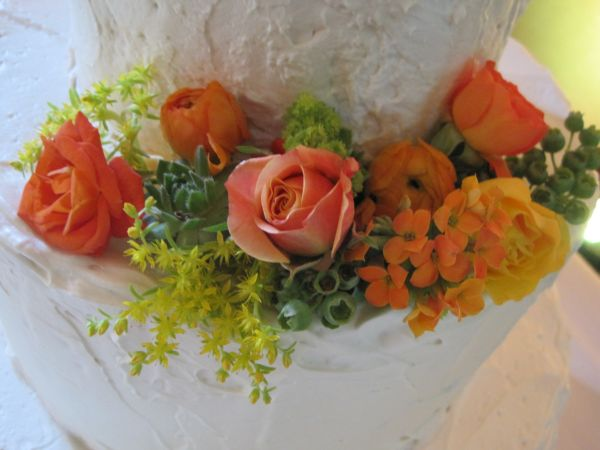 cake decorations with orange, white and yellow flowers, texture and blueberries, McMinnemins Edgefield, Françoise Weeks