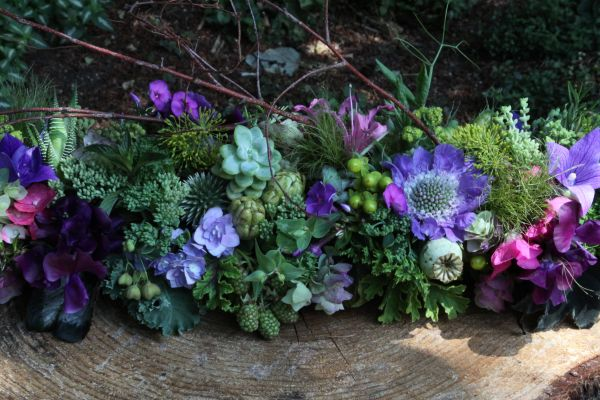 long arrangement with flowers, texture and berries, Françoise Weeks