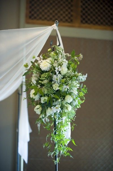 cascading arrangement of white and green flowers for chuppah, Governor Hotel, Françoise Weeks