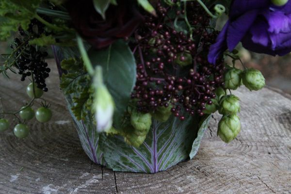 jewel toned arrangement with hops in cabbage container, Françoise Weeks