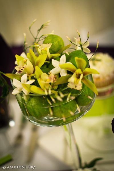 centerpiece with keylimes, orchids and stephanotis, Embassy Suites, Françoise Weeks