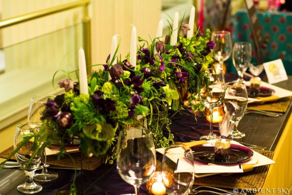 purple and green arrangement with candles, Embassy Suites, Françoise Weeks