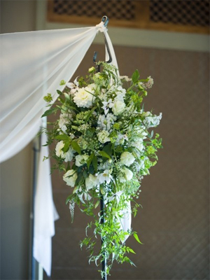 cascading arrangement of white and green flowers for chuppah, Françoise Weeks