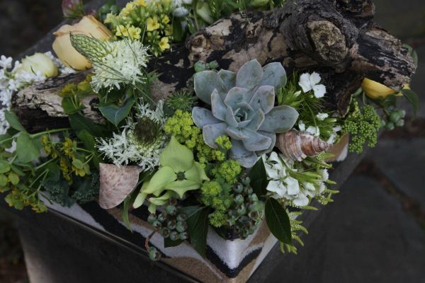 pale yellow, white and green arrangement with garden roses, lilac, kalanchoe in container filled with colored sand, Françoise Weeks