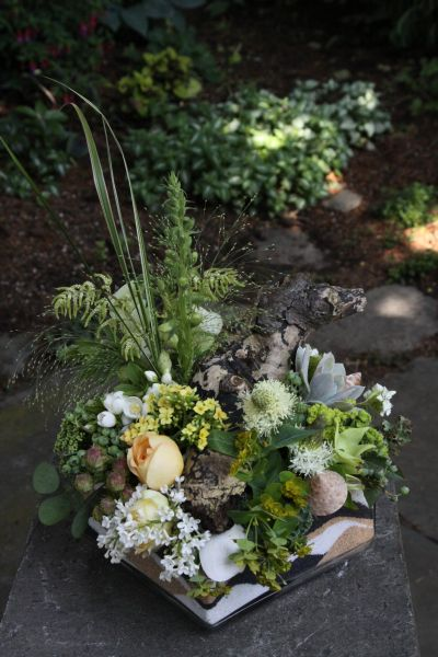 pale yellow, white and green arrangement with lilac, garden roses, kalanchoe in container filled with colored sand, Françoise Weeks
