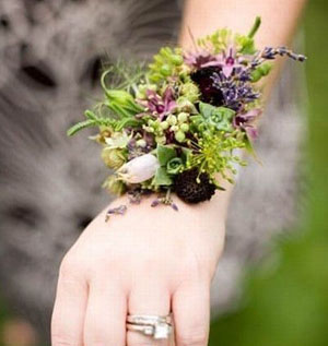 wrist corsage purple blossoms, berries, herbs